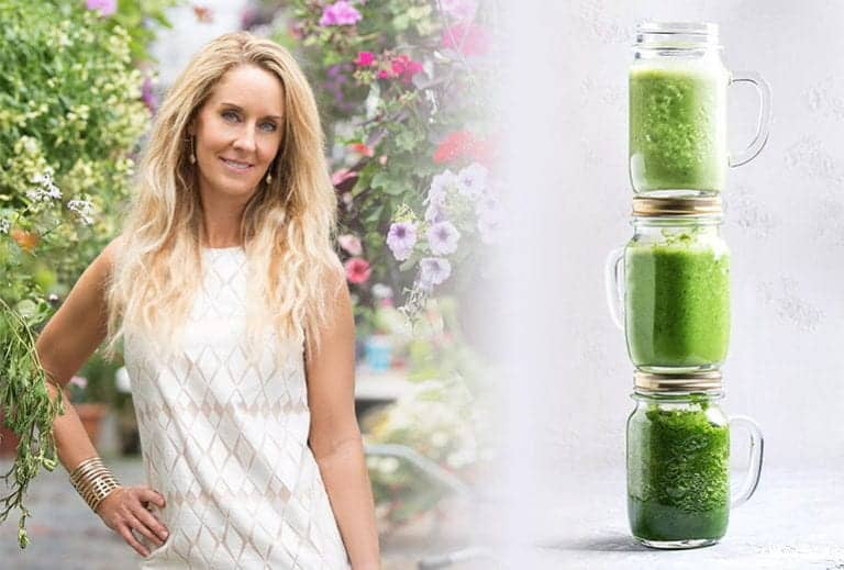 "Photo of Robyn Openshaw smiling with hand on hip and stack of green smoothies from How To Make A Green Smoothie: The Foolproof Guide"" by Green Smoothie Girl"