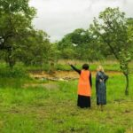 "Photo of African woman pointing and white woman looking from ""Why I Love Mothers Without Borders, And How We Can Help Them Together"" by Green Smoothie Girl"