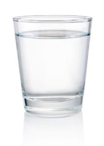 "Photo of glass of clear water on white background from ""Why I Developed The Flash Fast: Modified Fasting Made Easy And Fun"" by Green Smoothie Girl"