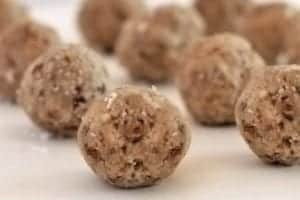 Photo of brown cashew coconut balls on pan from