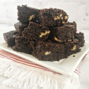 Photo of stacked brownies on white plate from