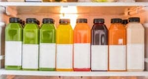"Photo of bottled label-less fruit juices in a row from ""What Can You Drink During Modified Fasting? Tips, Recipes, and Best Practices"" by Green Smoothie Girl"