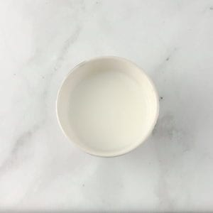 Photo of bowl of milk on marble counter from
