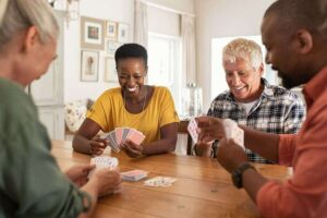 Photo of multiethnic mature friends playing cards from