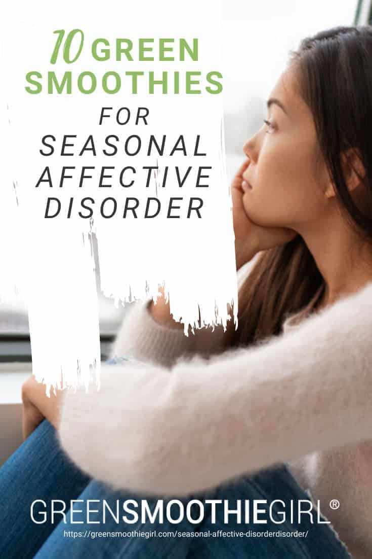 """Photo of sad Asian woman looking out window with post's title text overlay from """"10 Green Smoothies For Seasonal Affective Disorder"""" by Green Smoothie Girl"""