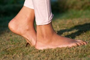 "Photo of girl's bare feet walking on grass from 'Is EMF Making You Sick?"" blog post by Green Smoothie Girl"