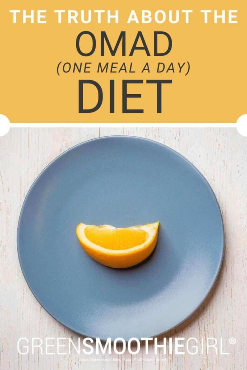 "Photo of a top-view blue plate with a single slice of orange fruit on it and post's title text overlaid from ""The Truth About The OMAD (One Meal a Day) Diet"" by Green Smoothie Girl"