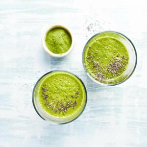 "Photo of top-view green smoothie with chia seeds on top from ""9 Green Smoothies For Clear, Younger-Looking Skin From The Inside Out"" by Green Smoothie Girl"