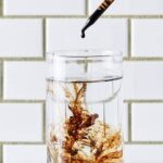 "Photo of dropper of dark fulvic acid liquid being dropped and suspended in clear water from ""How Fulvic Acid Improves Immunity"" blog post by Green Smoothie Girl"