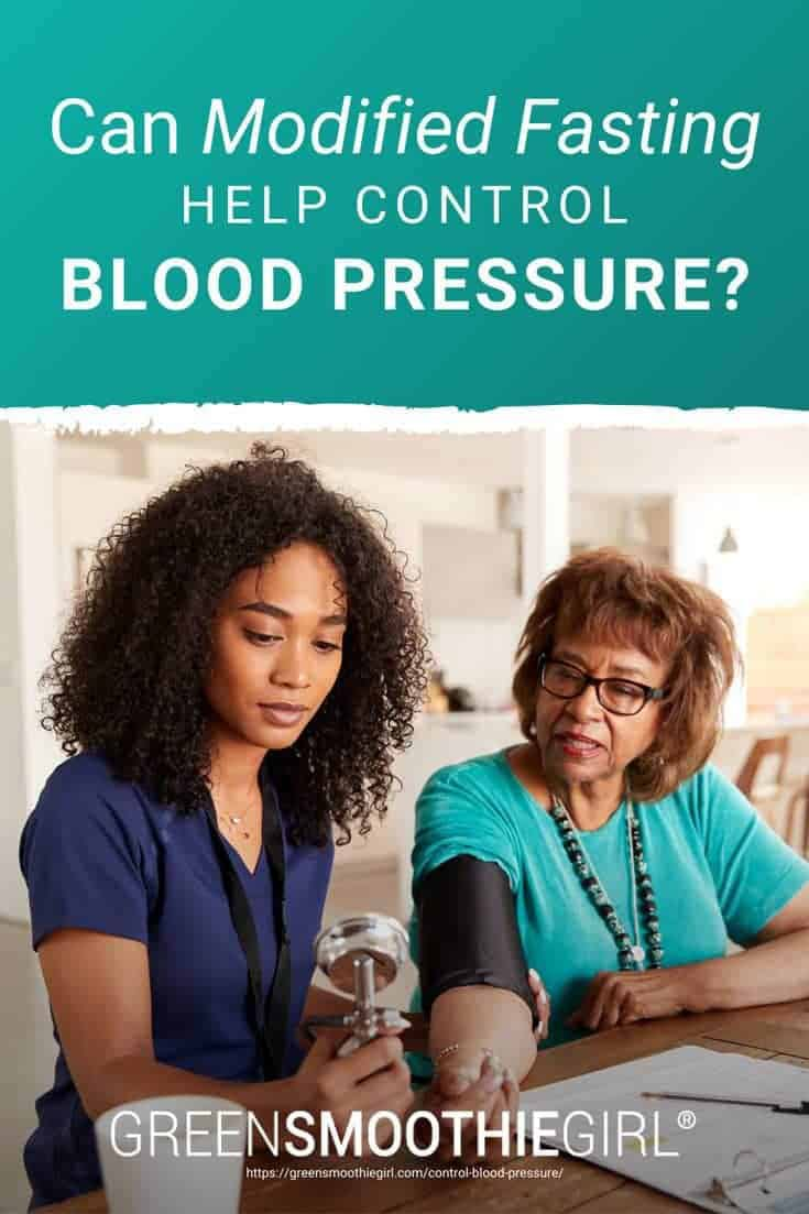 "Photo of African American female nurse helping elderly woman take blood pressure and post's title text overlaid from ""Can Modified Fasting Help Control Blood Pressure?"" by Green Smoothie Girl"