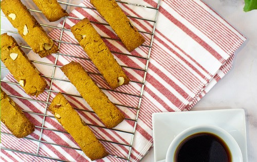 "slices of biscotti on a tray over a red and white cloth from Green Smoothie Girl's ""Chocolate Pumpkin High-Protein Biscotti Recipe"""
