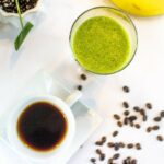 """A cup of coffee next to a glass of green smoothie with coffee beans scattered around from Green Smoothie Girl's """"Wake Up! Green Smoothie"""""""