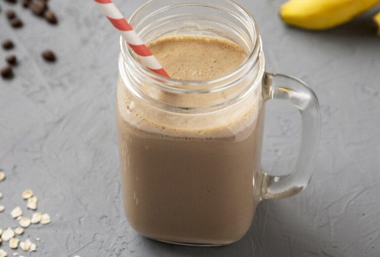 """image of a smoothie in a glass mug with a red and white smoothie on a gray background from GreenSmoothieGirl's recipe """"Chocolatey Mint Coffee Smoothie"""""""